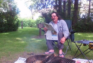 Gary telling a story, while reading the paper