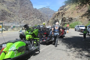 Waiting with a group of riders to cross the dam